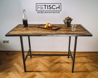 Dining table made of steel and wood