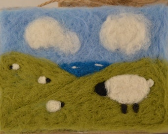 Needle felted woolly sheep on the hill