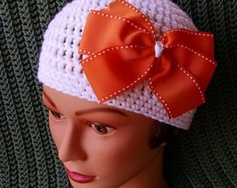 Crocheted child's hat added bow