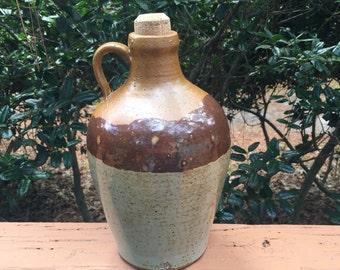Brown growler whiskey jug