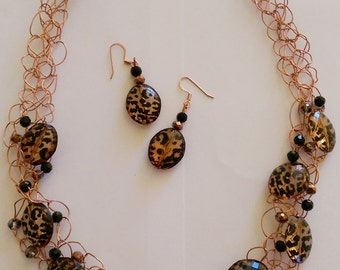 Copper wire crocheted necklace and earrings with unique animal print bead.