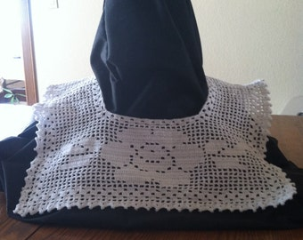 Square crocheted collar with flower on front.