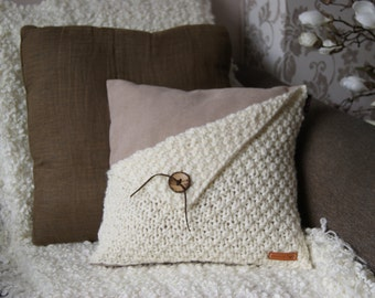 Off white with beige pillow with cover