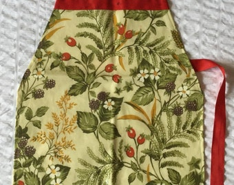 Used child's oilcloth apron