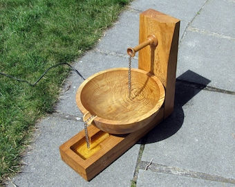 Beautiful wooden water fountain