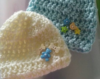2 baby boy soft crocheted hats with embellishments. Size 0-3 months
