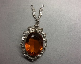 Vintage, Circa 30's Amber Colored Stone Pendant, surrounded by a Stylized Ribbon