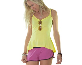 Yellow Flared Singlet made with natural fabric, perfect for wokouts, with shaped waist, longer at back with flaring at hips to cover booty