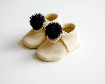 Natural chamois leather moccasins for baby, pompon, black, baby shoes, first shoes