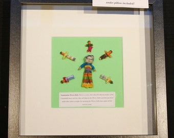 Guatemalan worry doll picture  in black box frame with separate worry doll in pouch.