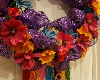 Purple fiesta wreath with ribbon and mesh on grapevine