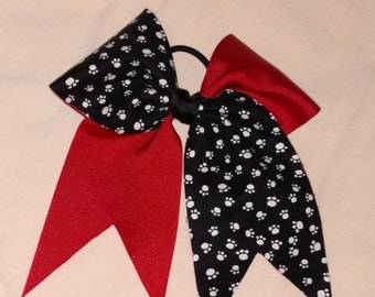 red/ paw print cheer bow