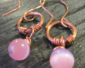 Copper earrings with pink bead