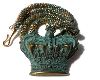 Blue & Gold Crown Pendant On A Kumihimo Necklace