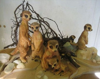 "The life of the meerkats""- wood carving"