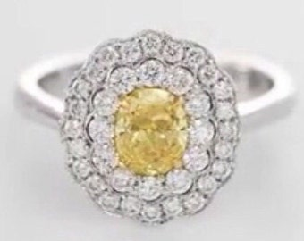 Gold ring with diamonds, central 1.10 CT fenci
