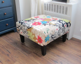Upholstered Ottoman With A Vibrant Floral Print To Brighten The Gloomiest Day