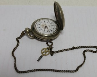 Vintage pocket watch with key
