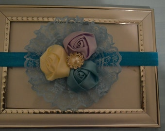 lacey headband with rosette in trio with pearl embellishment