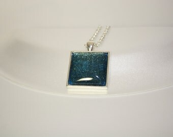 green shimmer square pendant on 20 inch silver chain