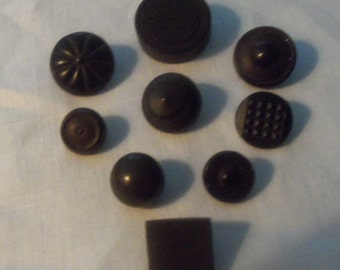 Lot of Nine Black Goodyear Rubber Buttons