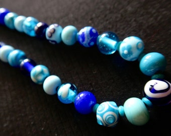Beautiful necklace of blue glass beads.