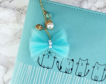Adorable bow and precious stones charm!