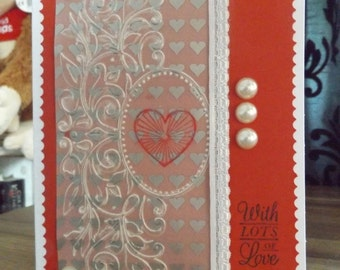 A handmade greetings card 'With LOTS OF Love'