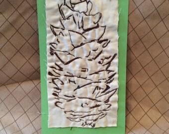 Machine embroidered pinecone