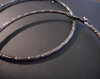 Metallic black hoop earrings
