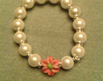 Glass pearl bracelet with lampwork rose and swarovski spacers