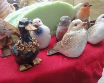 7 assorted bird figurines