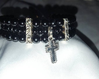 Black beaded bracelet with cross charm