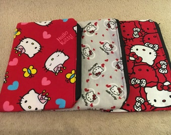 Three Hello Kitty Pouch Bags