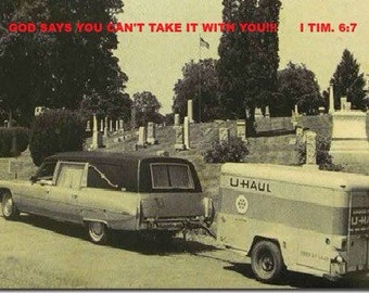 Hearse Pulling U-Haul With Bible Verse