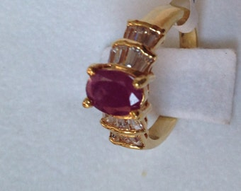 Gold over sterling silver ring set with rubi stone size 5.5  (# 137)