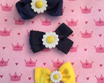 Bows with white daisies with yellow center