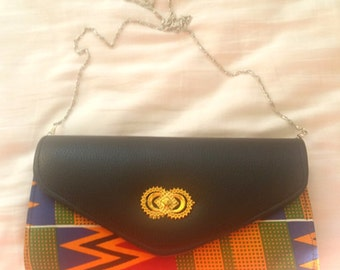 Kente and faux leather clutch