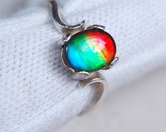 Ammolite Ring for the small hand.Grade AA 4 colour beauty with BIG impact.
