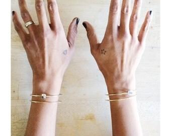friendship bracelets - emotional geometry - for the wrist.  the bangle