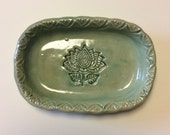 Green 4 by 6 inch soap dish with lotus pattern.