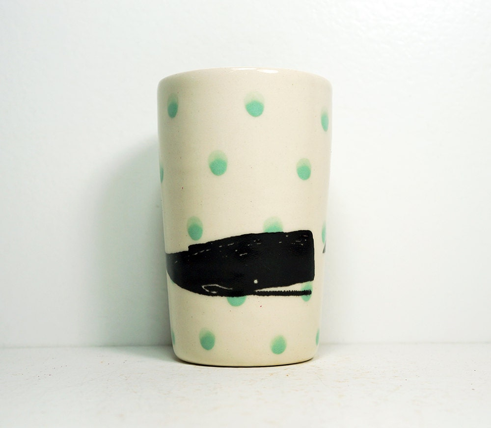 itty bitty cylinder/vase/cup with blue-green polkadots and a little whale on it, made to order.