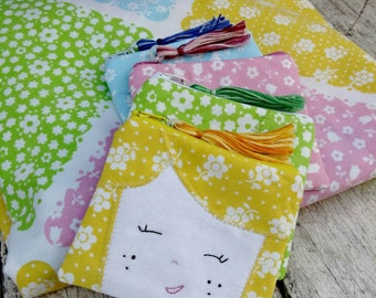 Dollface zipper pouch from upcycled vintage sheets. Cute coin purse, necessities bag. Embroidered face. Pink, blue, yellow, green.