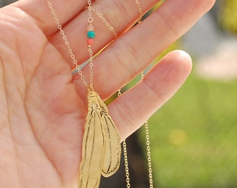 Modern Feather Tribal Necklace - handcrafted sterling silver and gold long necklace handcrafted by Chocolate and Steel