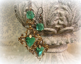 i dReam in green one of a kind vintage assemblage earrings . 100 per cent vintage findings swarovski hearts emerald green deco glass cubes