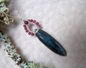 Faceted teal Kyanite briolette, tiny garnet, sterling silver neckace