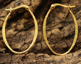 Gold plated silver loops earrings with texture