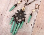 GHOST TOWN - Western Spur, Turquoise Dyed Howlite, Carved Skulls Necklace And Earring Set