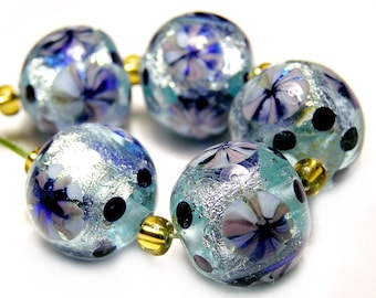 Hand made lampwork rounds in turquoise blue with murrini flowers on silver foil