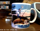 Greetings from the Great Lakes-Vintage Postcard Design-Man riding fish- 11oz Ceramic Coffee Mug